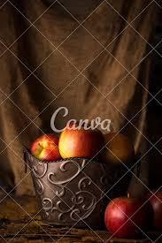 subdued lighting. Apples In Decorative Bucket Subdued Lighting