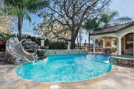 residential pools with slides. Plain Slides This Slide Is Also Set Into A Stone Water Feature Makes The Look Throughout Residential Pools With Slides