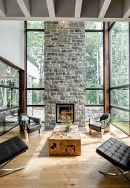 the living room boasts a modish style with tall brick fireplace photo credit dominic
