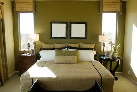 Bedroom with Green/Brown/Tan. Large leaf rug, tan/brown bedding