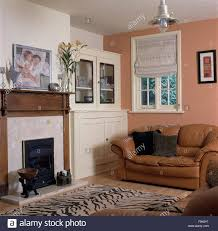 Living Room With Leather Sofa White Blind On Window Above Tan Leather Sofa In Pink Nineties
