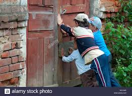 yartsevo russia august 15 2012 children hold closed door of an old
