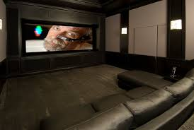 Small Picture Home Theater showing large lcd and square wall light on the wall