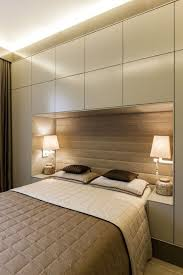 pure italian custom made built in closets around the bed in abudhabi