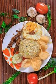 Push the rice to one side of the wok and add beaten eggs in the middle to fry slightly. Nasi Goreng Kampung Kampung Style Fried Rice Made Together With Our Fried Rice Special Recepie And Is Topped With A Fried Egg Together With 2 Satays On The Side Picture Of