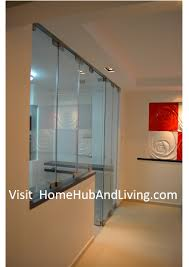 indoor kitchen and living room side view of frameless door 212x300 official site of latest frameless
