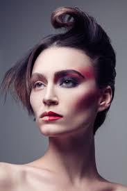 alex boldea wears a half faced makeup look