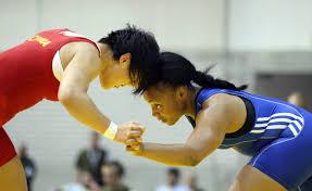 File:U.S. Army World Class Athlete Program wrestler Sgt. Iris Smith (right)  defeats Chinas Lijun Yang.jpg - Wikimedia Commons