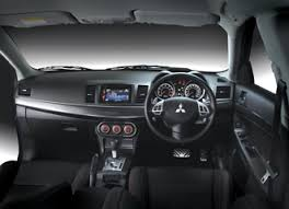 mitsubishi galant 2013 interior. a glimpse of the mitsubishi lancer sportback vrx interior modern materials and blue lighting look galant 2013