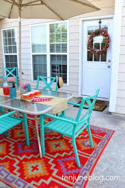 elegant patio with colorful outdoor reveal rug and light