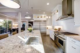 artistic kitchens more white kitchen design features large bar style kitchen island with granite countertop