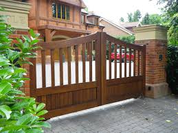wooden gate entrance designs for homes with red brick and elegant exterior color schemes