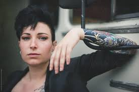 A Woman With Black Short Hair Leaning On A Bus By Chris Zielecki