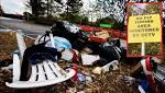 VIDEO: Fly-tippers pile junk outside Sainsburys - right underneath 'no-fly-tipping' sign