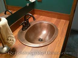 bathroom counter top resurfacing might sound like a daunting job i helped my hubby do our bathroom counter top