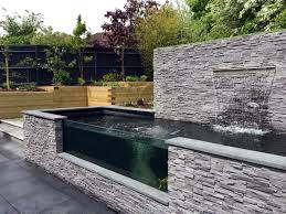 Small Picture Modern Sloping Garden with Feature Koi Pond Lush Garden Design