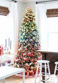 a faux Christmas tree decorated with ornaments of all shades possible