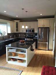 Centered island in a standard 10x10 kitchen. This kitchen is outfitted with  Deerfield pre-