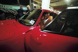 michael the everywhere man from vault com michael readies a cigar in his porsche after a home game in 1998