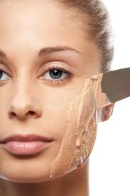 put on makeup foundation with spatula stock image image of attractive apply