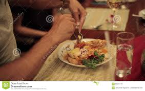 Close-up Hands Of Man Eating Lobster On ...