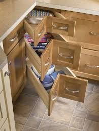 corner cabinet with drawers majestic pull out table schuler cabinetry