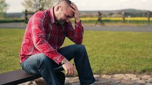 Image result for a man sitting on a  bench, head down