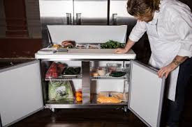 refrigerator table. a westwind wst47 prep table is open, displaying produce inside refrigerator