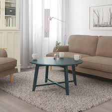 A smaller wooden coffee table can give your living room a very. How To Choose A Coffee Table According To An Interior Designer