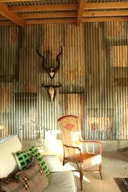 tin walls in garage the interiors feature a rustic chic look with recovered corrugated iron from tin walls in garage