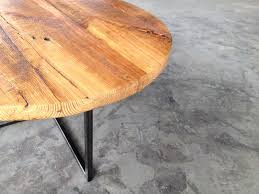 rounded reclaimed wood coffee table with black polished iron pedestal base unique
