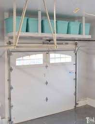take advantage of that empty space above your garage door build an overhead garage storage