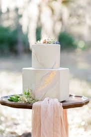 Two Tier Hexagonal Marble Wedding Cake With Shades Of Pink And