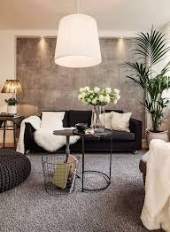 couch bedroom sofa: wallpaper living room inspiration black couch with neutral pillows sheepskin rug or throw big green plant big bean bag like chair wire basket for