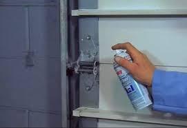 garage door chain off track clean lubricate drive chain maintaining garage door openers how to fix garage door chain off track