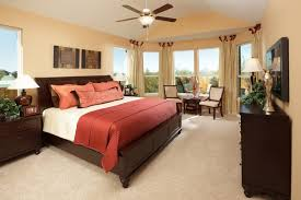 master bedroom interior decorating ideas with black furniture and red white bedding