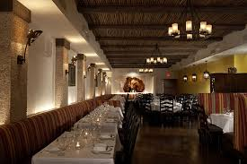 Realistic faux beams complete the ceiling design at this upscale eatery.