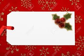a blank gift tag on a red snowflake background christmas gift a blank gift tag on a red snowflake background christmas gift stock photo 5669631