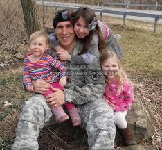 my military hero com west seneca bee second grader isabella stobert top hugs her father capt nate stobert