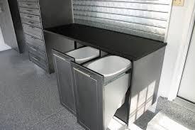 trash bin design in modern garage with black granite countertops and waste bin storage plus recyclable
