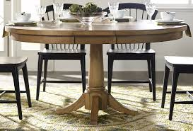 Candler Nutmeg Expandable Round Pedestal Dining Table From Liberty