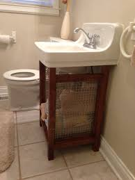 solution for old wall mounted sink that is super hard to replace pine boards and