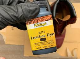 i used fiebing s black leather dye the dye itself comes with an applicator but is tricky as the cotton absorbs a lot of dye which tends to drip
