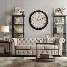 home and furniture chesterfield. i like the shelves and wall treatment behind sofa tribecca home knightsbridge beige linen tufted scroll arm chesterfield home furniture