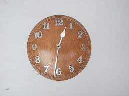 oak wall clocks round oak wall clock with inlaid walnut at the hour positions large light