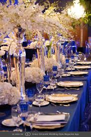 Royal blue tables with pops of gold and silver featuring phalaenopsis and  dendrobium orchids, hydrangea and French tulips. @grace_ormonde @wedding_