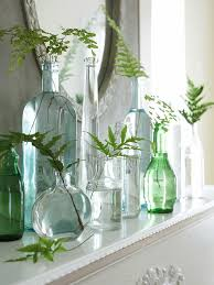 Create a simple spring mantel display by placing plant sprigs in pretty  vases and bottles. Various glass bottles with one sprig of greenery or tiny  flowers. ...