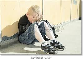 very sad boy in playground