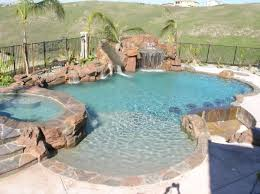 swimming pools with slides and waterfalls. Brilliant Pools Waterfall Grotto Slide And Sunken Bar This Custom Swimming Pool  With Swimming Pools Slides And Waterfalls T