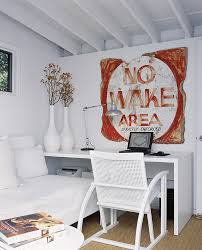 chic home office decor:  vintage sign adds color to the white home office design bruce bierman design